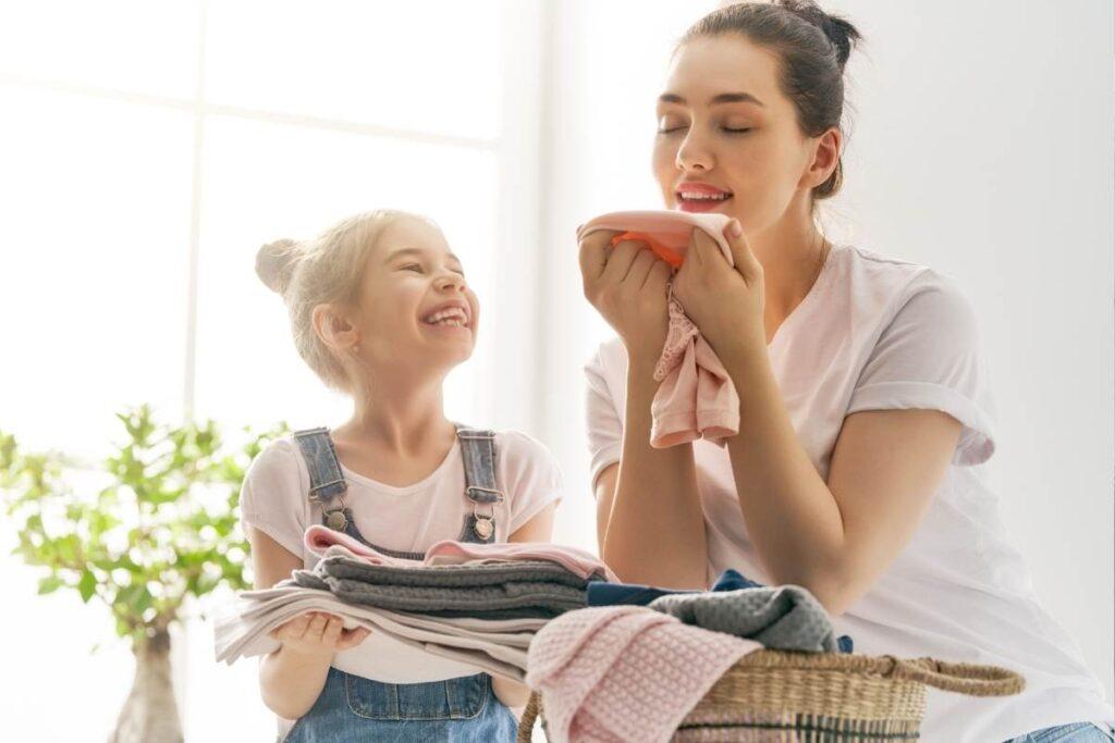 girls smelling fresh laundry
